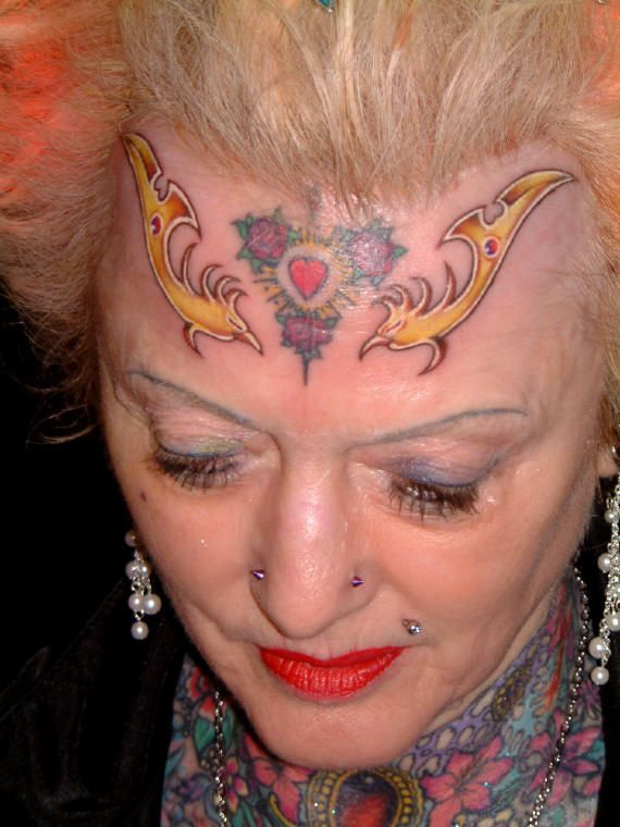 Disgusting tattooed old lady